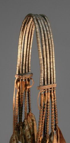 Rare Mfengu (Xhosa) Knee Piece worn by young men. Made of goatskin thongs and brass washers.
