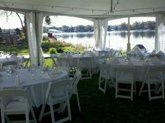 Our tent for a wedding on the lake. NOTE: the criss-cross lighting draped inside the tent