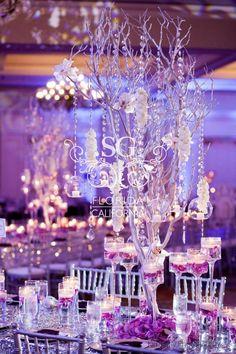 Suhaag Garden, Indian wedding decorator, Florida California Atlanta, wedding reception decor, silver and purple theme, silver manzanita tree branches, floating candles, centerpieces