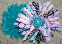 feather pad hair bow , korker flower can be with french clip alligator or headband $15.00 available wwwcraftychaton.com or craftychaton babyshower gift ect.(facebook) text 903 279 3472 tyler texas paypal and shipping available