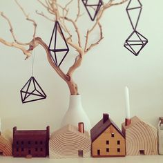 Finnish himmeli straw ornaments and a little wooden town = delightful handmade holiday decorations. Via jeanhclee on Flickr.