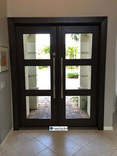 Open and airy front doors. Contemporary mahogany double wood doors with glass inserts and large pulls. This is nice, Contemporary Front Doors, Modern Front Door, Double Front Doors, House Front Door, The Doors, Entry Doors, Windows And Doors, Entryway, Double Doors Exterior