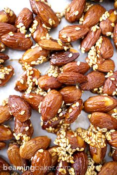 Sweet and smoky, skillet-roasted almonds glazed with a generous coat of honey and satisfying sesame seeds. Honey Sesame Almonds are the new go-to snack. Honey Roasted Almonds, Candied Almonds, Roasted Nuts, Glazed Almonds Recipe, Muesli, Granola, Nut Recipes, Almond Recipes, Snack Recipes