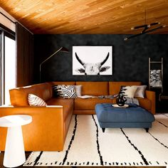 Love the Cabincore aesthetic? Try on the look in your home! Here are 5 ways to give your home a cabin-inspired look. Modern Mountain Home, A Frame Cabin, Tufted Ottoman, Ship Lap Walls, House Design, Interior Design, 5 Ways, Living Rooms, Decor Ideas