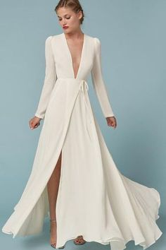 Low-key brides will love Reformation wedding gowns. The brand best known for effortlessly cool, eco-friendly dresses is now in the bridal game with designs like this one. The flattering wrap style and plunging V-neck are perfect for nuptials with a bohemian theme. (We're also obsessed with this one.)
