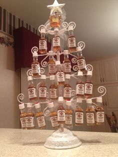 Whiskey advent calendar!! How awesome is this?!?  I made it for my mom and dad who love their Jim Beam and Crown. Base is a card holder I purchased at JCPenney 2014.  Enjoy!