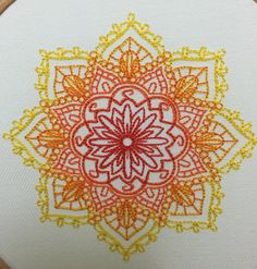 Available in any colour stitching you would like on black, white or natural cotton - just ask   Mandala ~ Indian style embroidery - red centre radiating out through orange to yellow on white heavy cotton drill. Finished with a red hanging ribbon  Machine embroidered using quality rayon colourfast thread on 100% cotton drill, framed under tension in a 7 British made beech embroidery hoop, the back is enclosed with felt to cover embroidery and also protect your wall from any marks. Thanks…