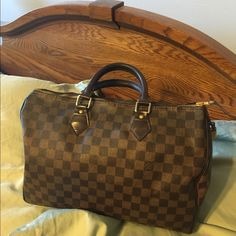 Authentic Louis Vuitton Speedy 35 Bag, good shape Louis Vuitton Speedy 35 Purse Authentic large size, holds a lot. Good, Previously loved condition, if you want one close to brand new this is not it. Great for girl who wants a good LV bag without the high price. Has the lock and both keys and they do work!  I believe it was made in 2010 but date code is provided so you can see for yourself, leather trim. A great, sturdy bag.  I do not wear it anymore cause I have a more colorful LV that I…