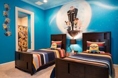 "The moon and stars glow in the dark in this  ""Despicable Me""-themed bedroom. Kids can even try to find all the hidden minions in this bedroom."