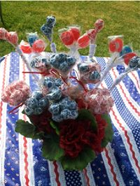 Make a beautiful #4thofJuly table #decoration with #red, #white and #blue #DumDums and #SafTPops from #SpanglerCandy. This is a #tasty #centerpiece that's sure to please #kids and adults!