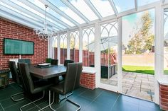 Four double bedroom, three bathroom, three reception townhouse set over three floors. This stunning property is stylish and immaculate throughout with an abundance of natural light. Conservatory used as dining room. Glass ceiling. Doors leading to a smart garden.