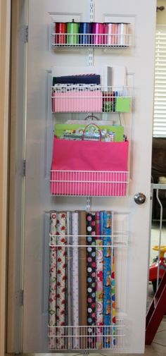 Wrapping paper organizer: elfa components from The Container Store. Deep and shallow baskets, use the Media Storage rack for the tall paper to go in.