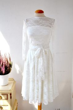 Short lace wedding dress. Add a tear away skirt and it would be ...