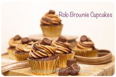 Rolo Brownie Cupcakes, with a caramel centre, topped with chocolate caramel swirled buttercream, drizzled with chocolate and finished with a Rolo.