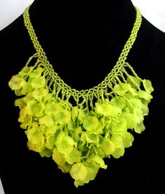 I made this using acrylic petals. Love this type of necklace in the summer, they are light and just plain fun.