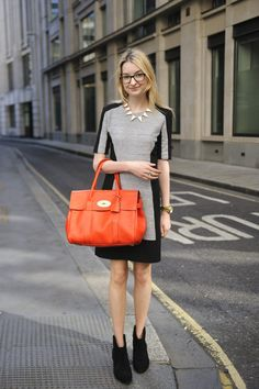 An orange carryall adds a burst of personality to a clean-lined look.