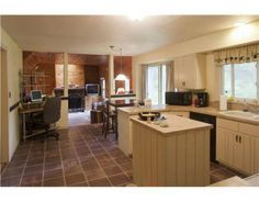 I love the way this beautiful kitchen leads through a breakfast nook, into a cozy den with finished pine walls and a stone fireplace. Beautiful! (This house is for sale in Orrington, but way out of my price range...lol)