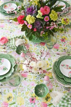 Hopping into Spring Table with pastel bunny floral salad plates, cabbage leaf chargers and glittery eggs in egg cups   homeiswheretheboatis.net #Easter #tablescape