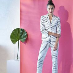 Punch up a tailored suit with a fun pattern and a sleek updo.