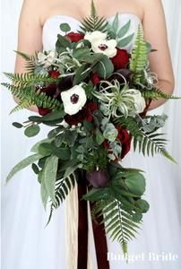 Burgundy wine wedding bouquet cascading with roses, anemones, fern, seeded eucalyptus, lots of greenery and air plants Super bohemian rustic wedding Air plants wedding bouquet Fern Bouquet, Anemone Bouquet, Cascade Bouquet, Anemones, Burgundy Wedding Flowers, Cascading Wedding Bouquets, Bride Bouquets, Wedding Mood Board, Seeded Eucalyptus
