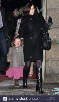 Danish Crown Princess Mary and Princess Isabella leave after attending a ballet performance at the Tivoli in Copenhagen, Denmark, 10 December 2010.
