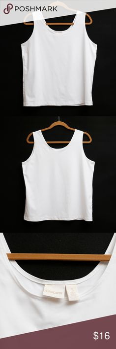 "Chico's - White Tank - Size 3 White Chico's Tank.  Great for layering! Size 3 (16 according to size chart.  See last photo).  Fabric tag has been cut out, but this is a soft,  stretchy polyester/spandex/microfiber?  Approximate Measurements:   Pit seam to pit seam in front:  21"" Length from middle of shoulder to hem: 23.5"" Fabric content: Spandex/Polyester/Microfiber?  Fast shipper! Chico's Tops Tank Tops"