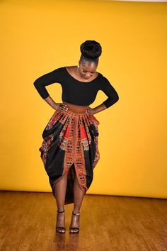 Dashiki Harem Skirt-Black by RAHYMA on Etsy. African print dashiki Harem skirt.  Pleated front and back waist with invisible back zipper.  Excellent fit.  3 inch waist band.  pattern is the same black dasgiki color but slightly different.   Dry clean only. (affiliate)