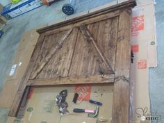 DIY barn door headboard. I wish I was still in Idaho for this one.