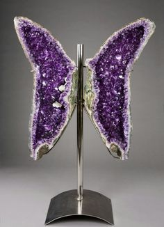 A beautiful, natural amethyst geode split down the center  mounted as seen here ... resembling a magnificent butterfly .....