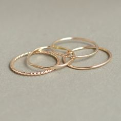 GOLD stacking rings. SET of four. skinny by MeadowbelleMarket