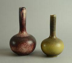 "Axel Salto for Royal Copenhagen, Two Gourd Vases | Stoneware bottle vase with orange-peel textured oxblood glaze, 1960s. Height 9 1/2"" Width 5 1/2"" Gourd-shaped bottle vase with solfatara glaze, 1964 Height 8"" Width 4 1/2"""