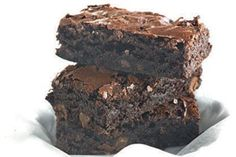 This recipe makes the best, fudgiest brownie ever. Serve it still warm from the oven, with vanilla ice cream. You need a good quality chocolate, something really dark. There is no vanilla essence, and even the nuts are optional; if you don't want them getting in the way, just omit them. The best thing about this brownie is that it keeps its texture and crumbly nature when stored in an airtight container.