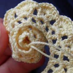 Rolling up the crochet rose