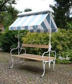 "PLAYING BENCH. Can be used on both sides and has a tent that can be ""rolled up"" and protected from the rain. (Janus) on Etsy, 2.100,00 €"