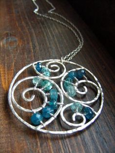 Wirework waves- love how they spanned across the spirals with beads