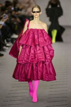 Balenciaga brought back couture for their 100th anniversary with looks like this dramatic fuchsia ruffled gown.