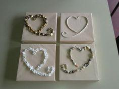 Vierluik van harten. knopen, klei, roosjes en schelpen