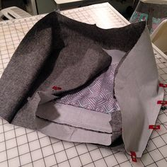 Welcome back! This Part 3 of the Evelyn Tutorial. Click hereforPart 1 > Click here for Part 2 > Step 8: Lining Assembly Lay your Top Zipper Panels (sewn to the zipper) bottom side down against the right side of a Bottom Lining panel, centering a long edge of the Top Zippered Panels along the …