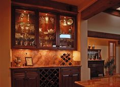 Something like this-- keep our 4 low cabinets, make bar of counters...use more granite, put in a decorative tile backsplash, make 2shelves up high, no glass, with 1wine display & something else...decanters?