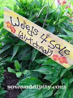 Turn old fence boards into cute garden signs