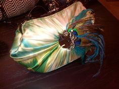 Beautiful feathers adorn this years evening clutches making fall all about color. Bag by Mary Fances www.JaxCouture.com