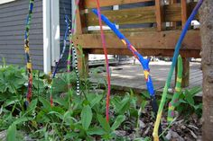 Garden sticks...I like these.  Recycle sticks, paint, then plant them to add color to your garden. Very unique!