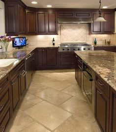 Travertine (probably Toreon) brickset at an angle with a matching travertine backsplash is a classic look for this kitchen.