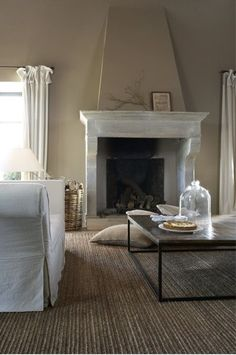 large marble fireplace .. great rug .. cloche on the table ..
