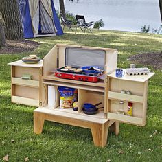 Camp kitchen woodworking plan. Stash all your campground cooking gear in one big box that sets up in seconds on your site. The camp kitchen features a windscreen that stows away for transport, a base that stacks on the box to for compact hauling, fold-out lids for ample prep space, and a paper-towel holder for mess cleanup.