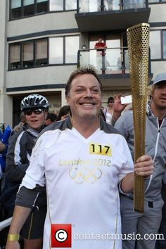Eddie Izzard carries the Olympic torch in Bexhill-On-Sea...