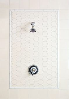 simple white tile shower feature - I like the three styles of tile, one color. Again like the tile border idea