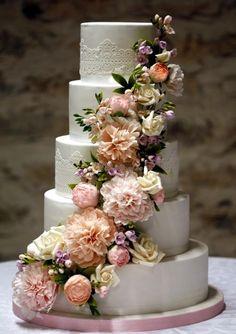 Wedding cake with peony, freesia and roses cascade