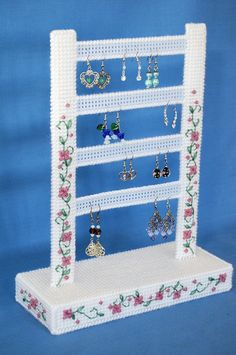NOTE: This is a digital pattern that you need to download to your computer. You will not receive the item pictured.  This pretty posy earring holder is both beautiful and functional! Displaying your earrings on this delicately lovely piece both lets you find your earrings easier and also lets you show them off for all to see. This is an original pattern designed by Julie Daelhousen (me!) to be worked in plastic canvas. Pattern is available as a PDF file.  Pattern uses 7-count plastic canvas…