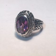 Silver Amethyst Ring Amethyst Ring. Not marked, so I'm not sure if it's silver or just silver plated. Size 7 Jewelry Rings